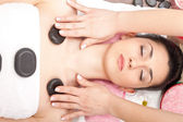 Treatment with hot mineral stone — Stock Photo