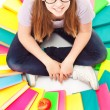 Teenager with pile of books and apple — Stock Photo