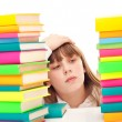 Worry schoolgirl with books — Stock Photo