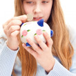 Stock Photo: Little girl with piggy bank