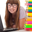 Girl between books and laptop — Stock Photo