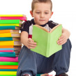 Little boy sitting on books — Stock Photo