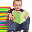 Little boy sitting on books — Stock Photo #5450784