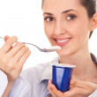 Young woman eating yogurt — Stock Photo #5450798
