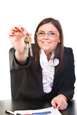 Business woman holds key — Stock Photo