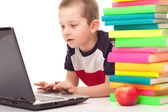 Preschooler on floor with books and laptop — Stock Photo
