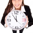 Businesswoman holding clock — Stockfoto