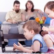 Baby girl and little boy playing on lap top — Stock Photo