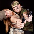 Army couple with guns — Stock Photo