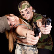 Army couple with guns - Stock Photo