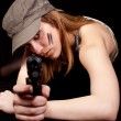 Woman solder with gun - Stock Photo