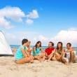 Young camping on beach — Stock Photo