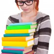 Sad school girl with stack color books — Stockfoto