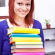 Teenage holding pile of books — Stock Photo