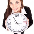 Businesswoman in suit holding a clock — Stock Photo #5562637