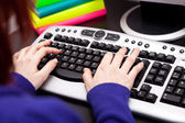 Typing on keyboard - student internet — Stock Photo