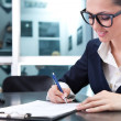 Young businesswoman signing a contract — Stock Photo #5615064