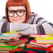 Teenage resting on stack of books — Stock Photo #5616420