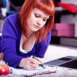 Stock Photo: Student writing homework
