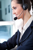 Woman with headset — Stock Photo