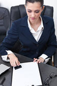 Businesswoman stamping documents — Stock Photo