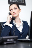 Busy businesswoman talking on phone — Stock Photo