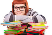 Teenage resting on stack of books — Stock Photo