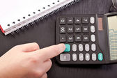 Finger on calculator — Stock Photo