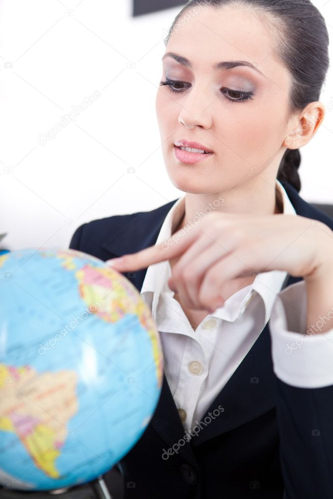 Businesswoman in office with globe searching destination for new job — Stock Photo #5615299