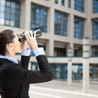 Businesswoman looks into the future — Stock Photo
