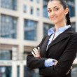 Stock Photo: Young businesswomis standing outdoors