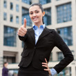 Businesswoman outside a modern office building — Stock Photo #5666597