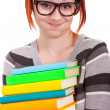 Fun schoolgirl with stack books — Stock Photo