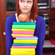 Girl with stack color book — Stock Photo