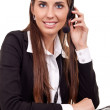 Businesswoman speak with headset — Stock Photo #5667140