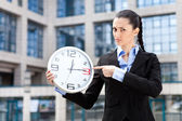 Businesswoman showing that running out of time — Stock Photo