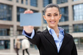 Businesswoman showing business card — Stock Photo