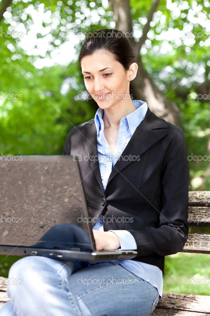 Overworked businesswoman working on break in green park  Stock Photo #5666037