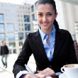 Businesswoman working on coffee break — Stock Photo