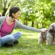 Young girl with a dog in the park — Stock Photo