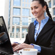 Businesswoman working on laptop outdoor — Stock Photo