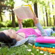 Relaxing in nature with book and music — Stock Photo #5722174