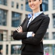 Businesswoman with her arms crossed — Stock Photo #5722743