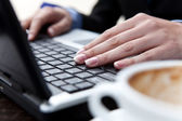 Hands typing on lap top — Stock Photo