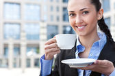 Smiling woman with cup of coffee — Stock Photo