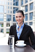 Businesswoman having break — Stockfoto