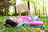Relaxing in nature with book and music — Stock Photo