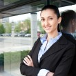 Businesswoman standing outside an office building — Stock Photo