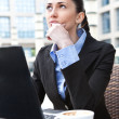 Young business woman thinking — Foto Stock