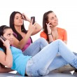 Three girls with phones — Stock Photo